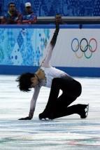 """Yuzuru Hanyu at the 2014 Olympics (2)"" by David W. Carmichael.  http://davecskatingphoto.com/photos_2014_olympics_men.html"